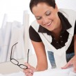 Young female architect with plans at the office — Stock Photo