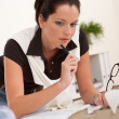 Young female architect writing with pen — Stock Photo