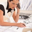 Female architect busy at the office calling — Stock Photo #4694923