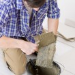 Home improvement - handyman laying tile — Foto de Stock