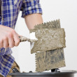 Home improvement - handyman laying tile - Stock Photo
