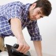 Home improvement - handyman laying tile — Stock Photo #4694963