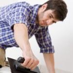 Home improvement - handyman laying tile — Stock Photo
