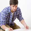 Home improvement - handyman laying tile — Stock Photo #4694969