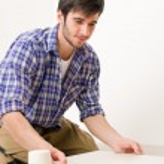 Home improvement - handyman laying tile — Stock Photo #4694973