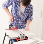 Home improvement - handyman cut tile — Stock Photo #4694998