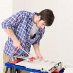 Home improvement - handyman cut tile — Stock Photo #4694999