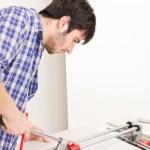 Home improvement - handyman cut tile — Stock Photo #4695000