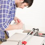 Home improvement - handyman cut tile — Stock Photo #4695004