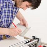 Home improvement - handyman cut tile — Stock Photo #4695005
