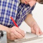 Home improvement - handyman cut tile — Stock Photo