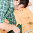 Home improvement - handyman installing wooden floor - Stok fotoğraf