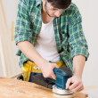 Royalty-Free Stock Photo: Home improvement - handyman sanding wooden floor
