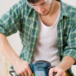 Home improvement - handyman sanding wooden floor — Stockfoto