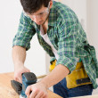 Home improvement - handyman sanding wooden floor — Zdjęcie stockowe