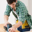 Home improvement - handyman sanding wooden floor — Photo
