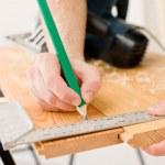 Home improvement - handyman prepare wooden floor — Stock Photo