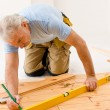 Royalty-Free Stock Photo: Home improvement - handyman installing wooden floor