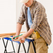 Stock Photo: Home improvement - handyman prepare wooden floor