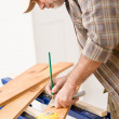 Royalty-Free Stock Photo: Home improvement - handyman prepare wooden floor