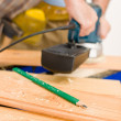 Home improvement - handyman sanding wooden floor — Stock Photo #4695223