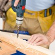 Home improvement - handyman drilling wood - Stock Photo