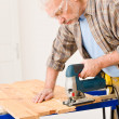 Home improvement - handyman cut wood with jigsaw — Foto de Stock