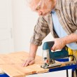 Home improvement - handyman cut wood with jigsaw — Stock Photo #4695240
