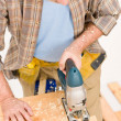Home improvement - handyman cut wood with jigsaw — Stock Photo #4695241