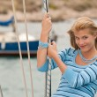 Blond young woman on sailing boat — Stock Photo