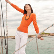 Stock Photo: Attractive womsailing on luxury yacht
