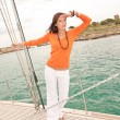 Attractive woman sailing on luxury yacht — Stock Photo