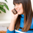 Teenager girl relax home - on phone — Stock Photo