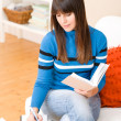 Teenager girl home - student write homework — Stock Photo