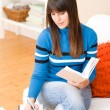 Teenager girl home - student write homework — Stock Photo #4695325