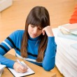 Teenager girl home - student write homework - Zdjęcie stockowe