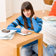 Teenager girl home - student write homework — Stock Photo #4695333