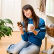 Teenager girl relax home - listen to music - Stock Photo