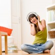 Teenager girl relax home - happy listen to music — Stock Photo