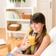Happy teenager girl sitting home on sofa — Stock Photo