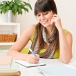 Teenager girl home - student write homework - Stock Photo