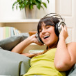 Teenager girl relax home - happy listen to music — Stock Photo #4695391