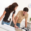 Young man and woman working at architect office — Stock Photo #4695624