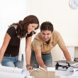 Young man and woman working at architect office — Stock Photo #4695629