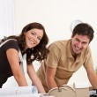 Smiling man and woman working — Stock Photo