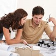 Young man and woman working at architect office - Stock Photo