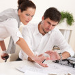 Young man and woman working together — Stock Photo