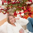 Royalty-Free Stock Photo: Blond smiling woman in front of Christmas tree
