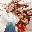 Royalty-Free Stock Photo: Happy young woman on Christmas