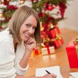 Royalty-Free Stock Photo: Attractive blond woman writing Christmas cards